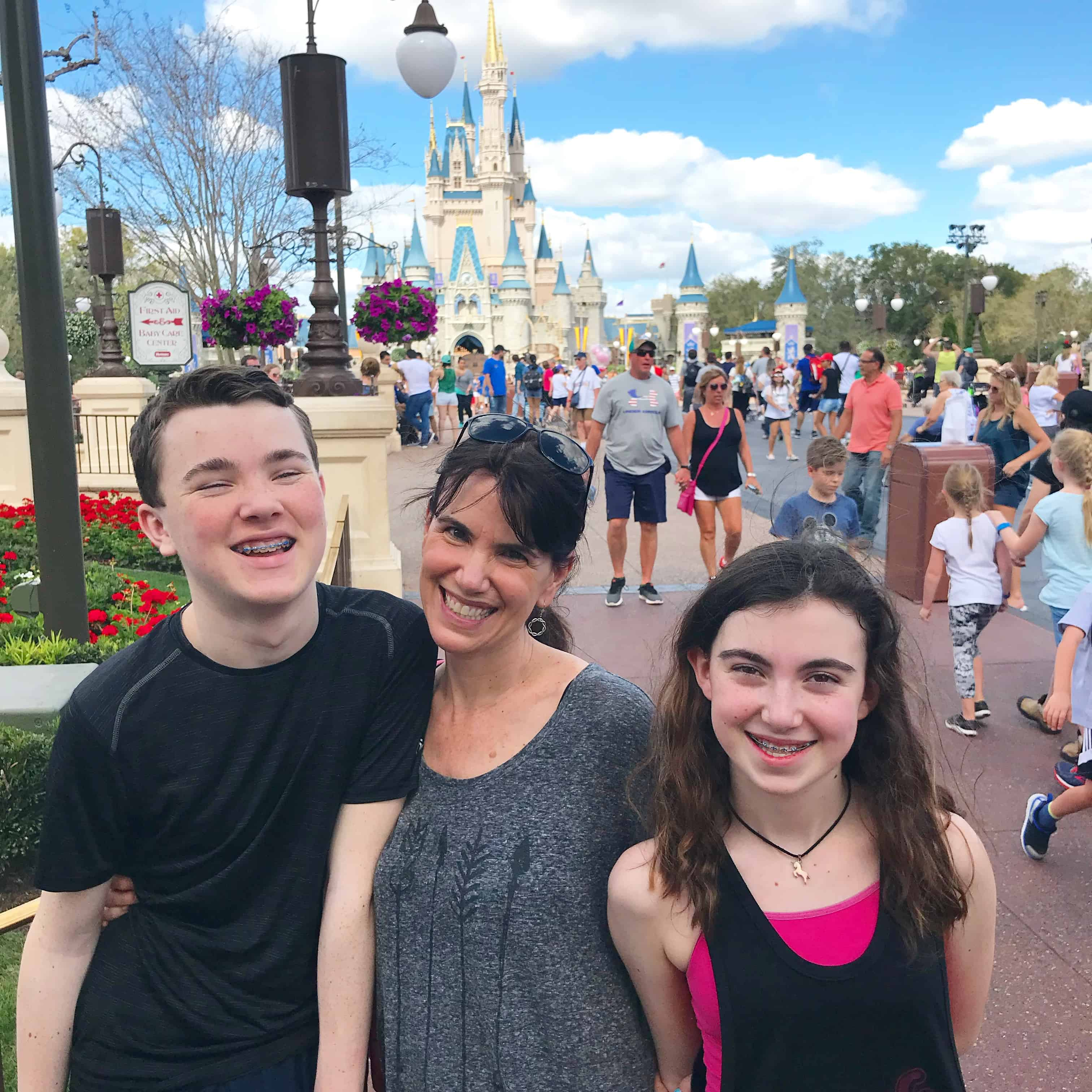 My son giggles as we enjoy our visit to Disney World