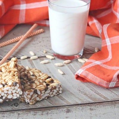 Healthy rice crispy treats next to a glass of milk