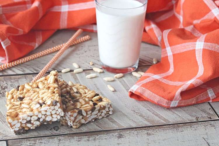 Healthy rice crispy treats next to a glass of milk