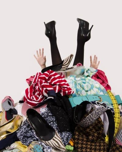 Woman sitting in a cluttered mess