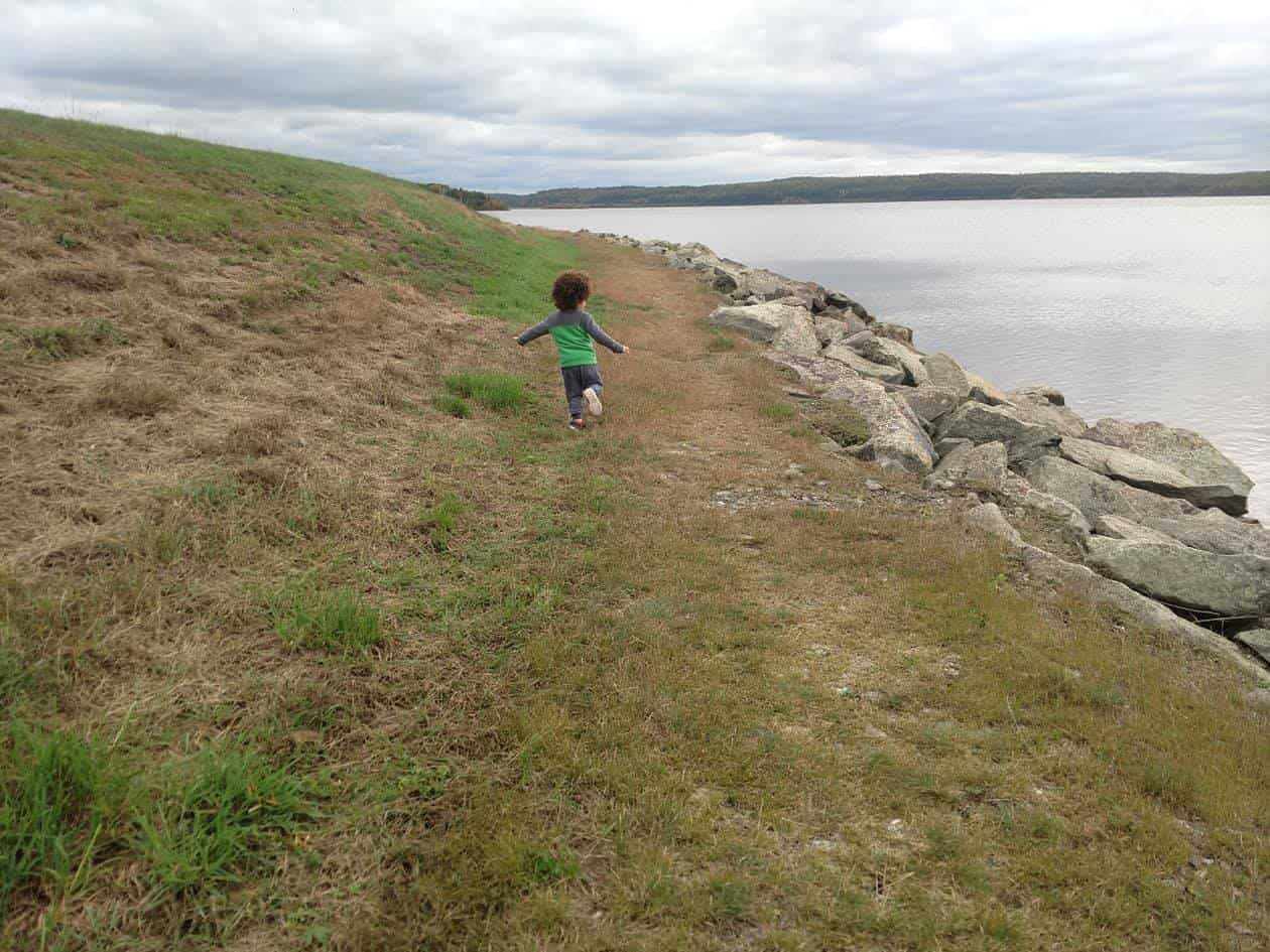 A child running around a nature trail