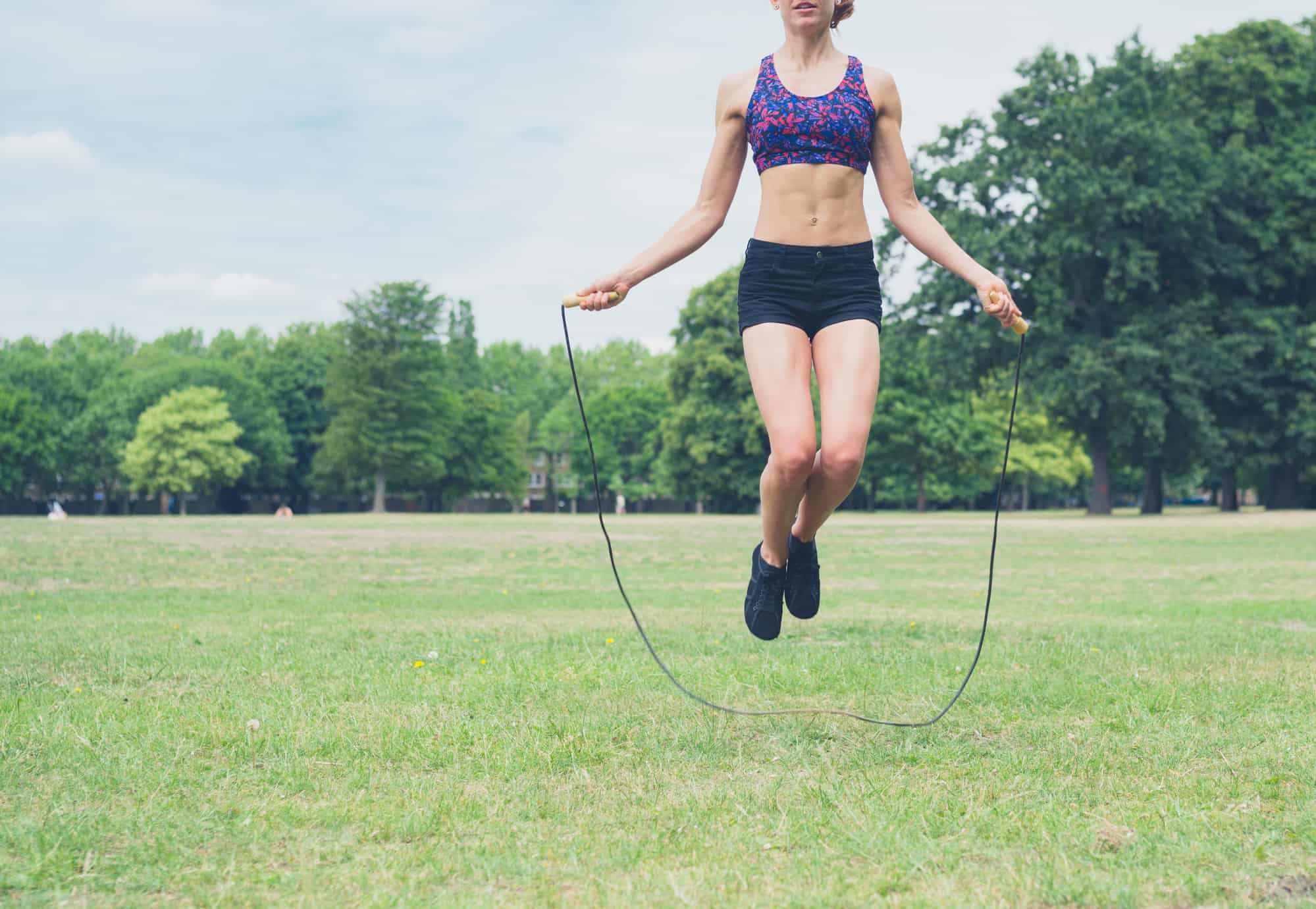 Young athletic woman jumping rope to burn 100 calories in eight minutes