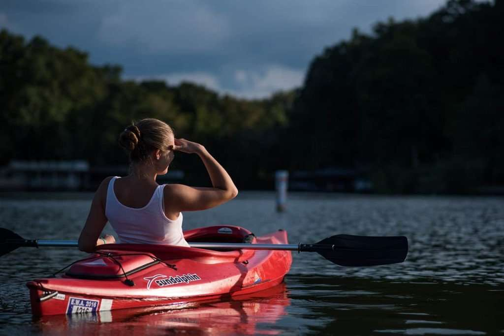 woman in kayak on lake
