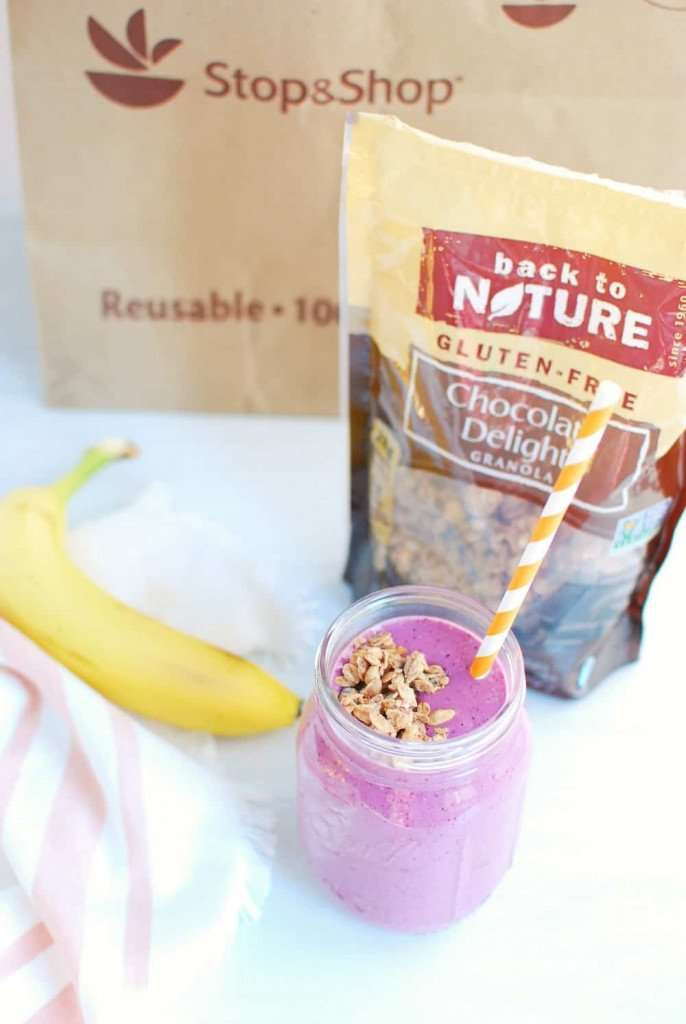 smoothie with banana and granola in background