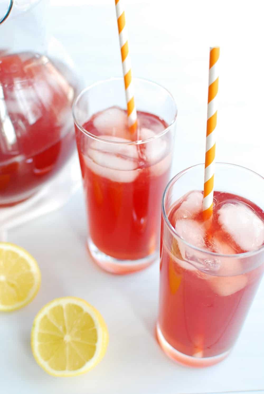 Two glasses full of sparkling pomegranate lemonade