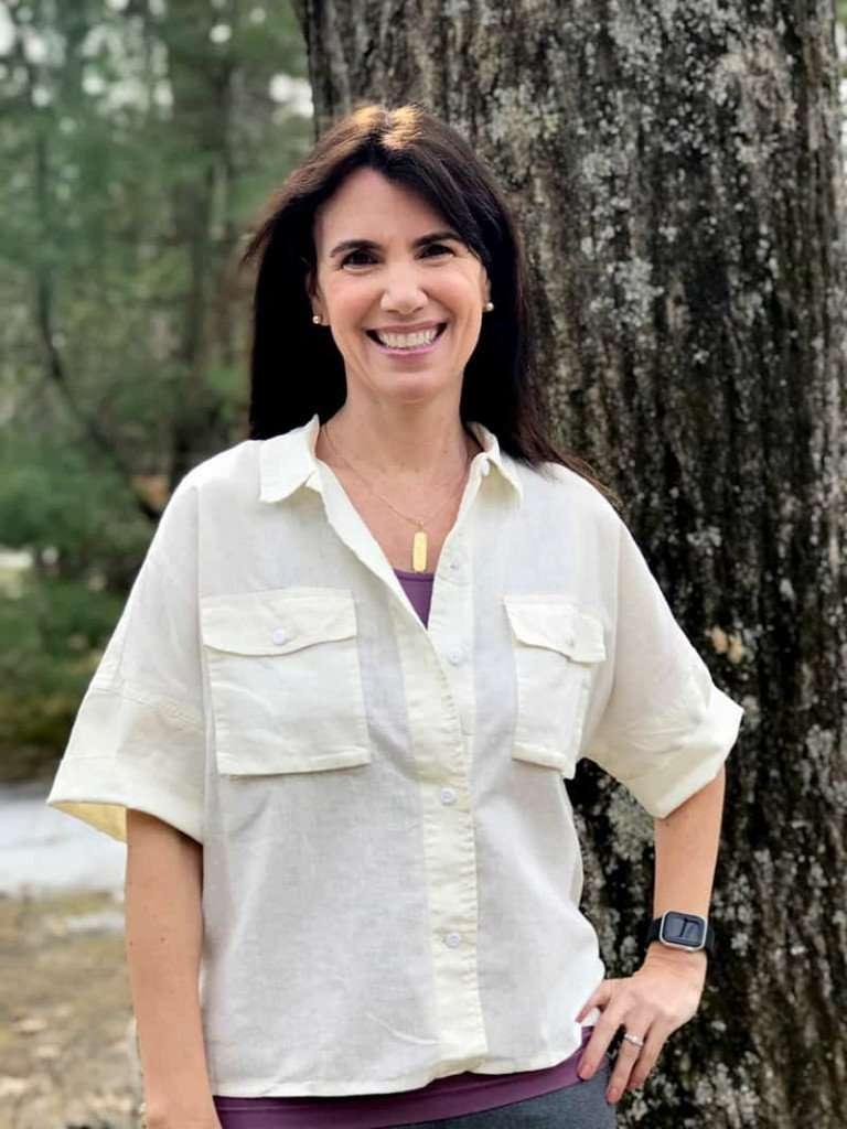woman in button down shirt from REI