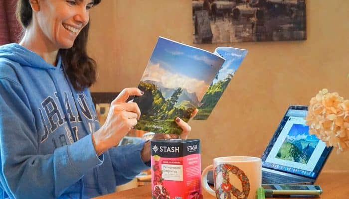 woman reading travel catalog