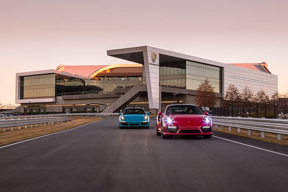 Blue and red Porsche on race track