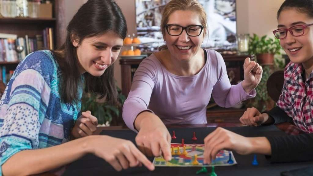 woman and girls playing games